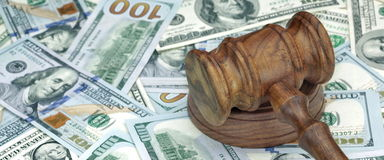 Judges or Auctioneers Hammer On Huge Money Heap Stock Image