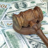 Judges or Auctioneers Hammer On Huge Money Heap. Judges or Auctioneers Gavel Or Hammer On Huge Heap Of Money On Wooden Table, Concept for Trial, Concept For royalty free stock image