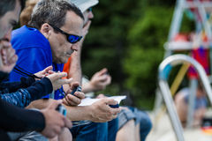 Judges with Chronometers Timing the Static Performances. MONTREAL, CIRCA JUNE 2014 - Two Hot Spring Days of Freediving Competition at Jean-Drapeau 50m Outdoor stock photography