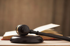Judges court gavel. And law books on a table Stock Photo