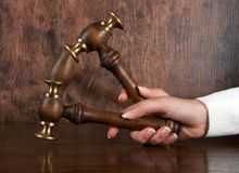 Judges gavel. Female judges gavel at the decisive moment royalty free stock images