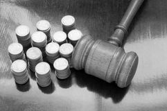 Judges gavel and coins Stock Image
