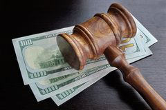 Judges Gavel And Dollar Cash  On The Black Table Stock Image