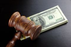 Judges Gavel And Dollar Cash  On The Black Table Royalty Free Stock Image