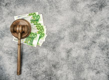 Judges Gavel and euro cash money. Auctioneer hammer. Judges Gavel on a stack of euro cash money. Auctioneer hammer with Soundboard royalty free stock photography