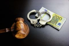 Judges Gavel, Handcuffs And Euro Cash  On The Black Table Royalty Free Stock Photo