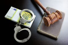 Judges Gavel, Handcuffs, Euro Cash And Book On  Black Table Royalty Free Stock Photography