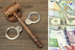 Judges Gavel, Handcuffs And International Money Stock Images