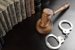 Judges Gavel, Handcuffs And Old Book On The Black Table Royalty Free Stock Images