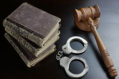 Judges Gavel, Handcuffs And Old Book On The Black Table Stock Image