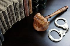 Judges Gavel, Handcuffs And Old Book On The Black Table Royalty Free Stock Photos