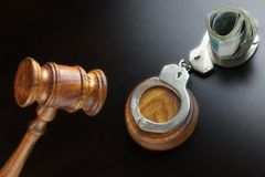 Judges Gavel, Handcuffs And  Russian Cash  On The Black Table Royalty Free Stock Images