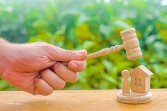 The judges gavel hovered over the wooden and human figure. Concept of justice and litigation. The decision of the fate of the defe. Ndant and property stock photos