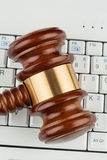 Judges gavel on keyboard Royalty Free Stock Images