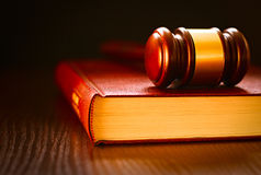 Judges gavel lying on a law book royalty free stock photos