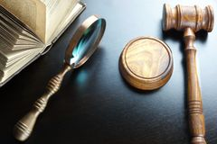 Judges Gavel, Magnifier And Old Book On The Black Table Stock Photography