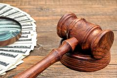 Judges Gavel, Money and Magnifying Glass Royalty Free Stock Images