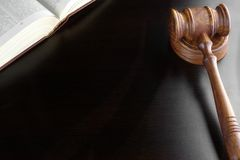 Judges Gavel And Old Book  On The Black Wooden Table Stock Photography