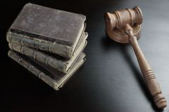 Judges Gavel And Old Book  On The Black Wooden Table Stock Images