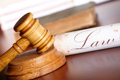 Judges gavel with old paper