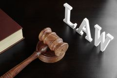 Judges Gavel, Red Book And Sign LAW On Black Table Royalty Free Stock Images