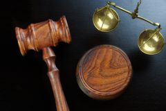 Judges Gavel And Scale Of Justice On The Black Table Stock Photography