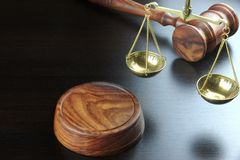 Judges Gavel And Scale Of Justice On The Black Table Royalty Free Stock Images