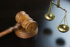 Judges Gavel And Scale Of Justice On The Black Table Royalty Free Stock Photo