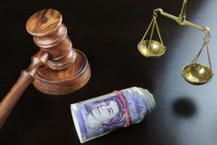 Judges Gavel,  Scale Of Justice And British Cash On Table Royalty Free Stock Images