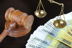 Judges Gavel, Scale Of Justice And Euro Cash On Table Stock Photos