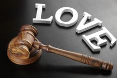 Judges Gavel And Sign Love On The Black Wood Background Stock Photos