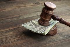 Judges Gavel, Soundboard And Bundle Of Money On The Table Royalty Free Stock Photography