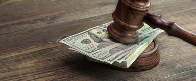 Judges Gavel, Soundboard And Bundle Of Money On The Table Stock Photos