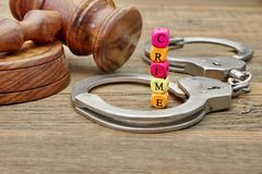 Judges Gavel, Soundboard,  Handcuffs and Sign CRIME Stock Photo