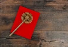 Judges Gavel Soundboard Red Book Hammer wooden background Stock Photos