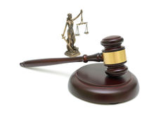 Judges gavel and the statue of justice on white background. royalty free stock image