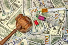 Judges Gavel And Syringe With Injection On Dollar Cash Backgroun Stock Photography