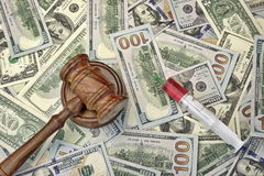 Judges Gavel And Syringe With Injection On Dollar Cash Backgroun Royalty Free Stock Images