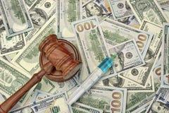 Judges Gavel And Syringe With Injection On Dollar Cash Backgroun Stock Image