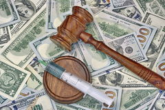Judges Gavel And Syringe With Injection On Dollar Cash Backgroun Stock Images