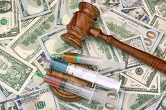 Judges Gavel And Syringe With Injection On Dollar Cash Backgroun Stock Photos