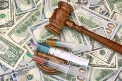 Judges Gavel And Syringe With Injection On Dollar Cash Backgroun Stock Photos