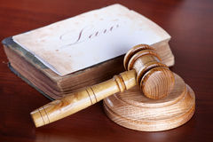 Judges gavel with very old book Royalty Free Stock Photo