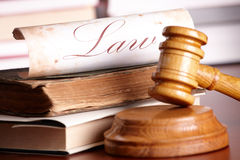 Judges gavel with very old books Royalty Free Stock Photo