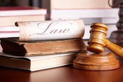 Judges gavel with very old books Royalty Free Stock Image