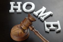 Judges Gavel And White Sign Home On Black Wood  Background. Royalty Free Stock Photo