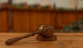 Judges gavel on wooden table. 3d rendering of judges gavel on court desk Stock Photo
