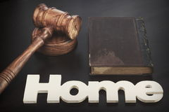 Judges Hammer or Gavel With Home Sign On Dark Background. Auctioneers or Judges Hammer or Gavel with White Home or House Sign On Black Wooden Background, Trial stock image