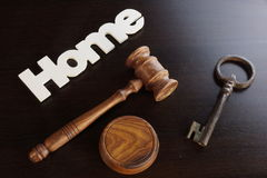 Judges Hammer or Gavel With Home Sign On Dark Background. Auctioneers or Judges Hammer or Gavel with White Home or House Sign On Black Wooden Background, Trial stock photography