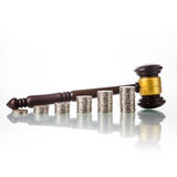 Judges law gavel with coins Royalty Free Stock Images